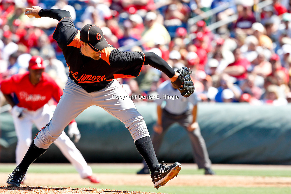 March 25, 2012; Clearwater, FL, USA; Baltimore Orioles relief pitcher Pat Neshek (48) throws against the Philadelphia Phillies during the bottom of the fifth inning of a spring training game at Bright House Networks Field. Mandatory Credit: Derick E. Hingle-US PRESSWIRE