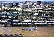 Aerial Of Airplane Landing At John Wayne Airport