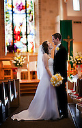 Feb 11, 2012; San Antonio, TX, USA; <br /> Bride and groom look at each other at altar of the Holy Trinity Catholic Church.  Images by San Antonio Wedding Photographer Soobum Im.