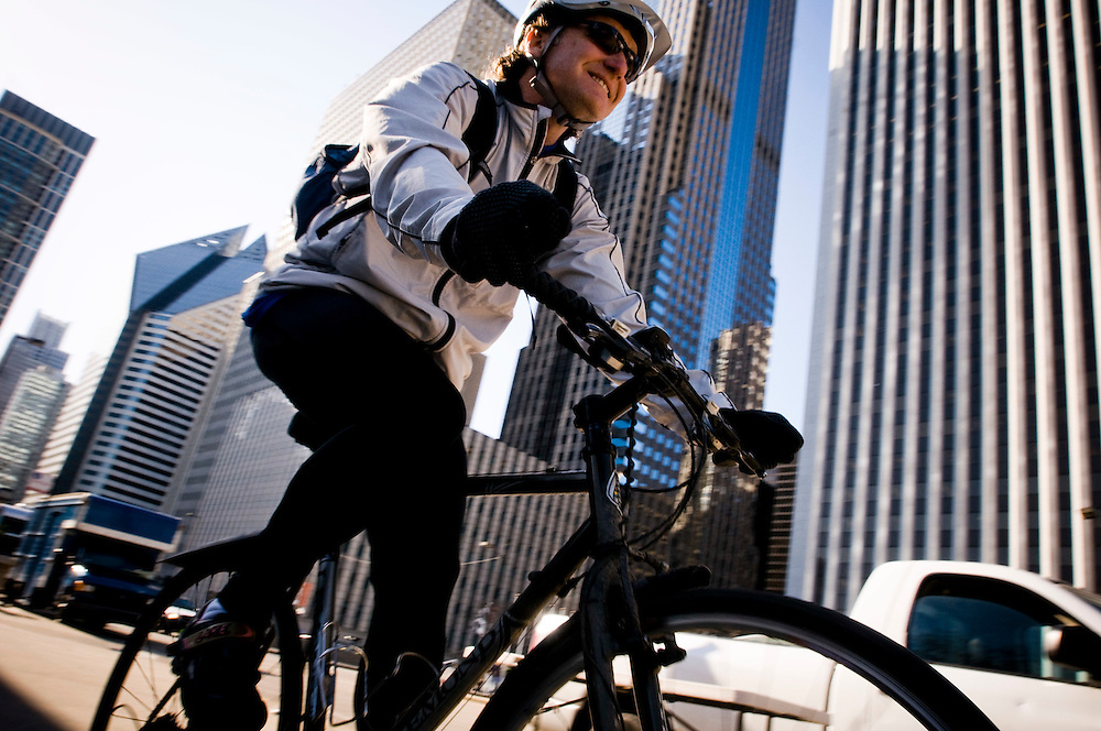 Pat Navin returning home on his bike after a day at the office in downtown Chicago. Pat is one of the regular bike commuters, and member of the Mcdonalds Cycle Center in Millenium Park, where commuters can park their bikes, shower and change before going to the office.<br /> <br /> The cycle center also rents bikes and organises Segway tours in central Chicago.<br /> <br /> Photographer: Chris Maluszynski /MOMENT