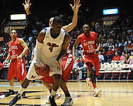 """Ole Miss' Demarco Cox (4) vs. Illinois State in a National Invitational Tournament game at the C.M. """"Tad"""" Smith Coliseum in Oxford, Miss. on Wednesday, March 14, 2012. (AP Photo/Oxford Eagle, Bruce Newman)"""
