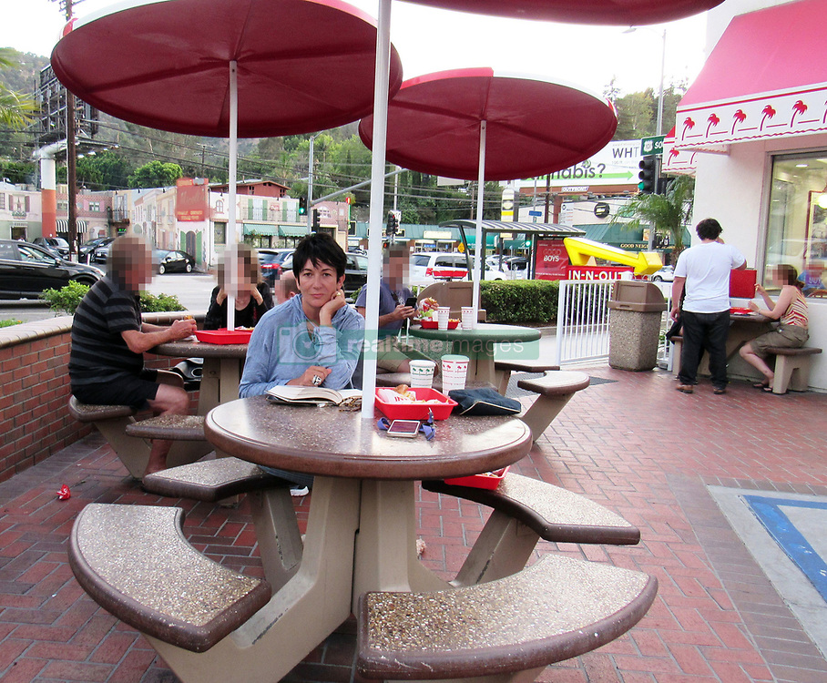 """**PREMIUM EXCLUSIVE** Ghislaine Maxwell, Jeffrey Epstein's former right hand woman, tucks into burger and fries at a fast-food joint in Los Angeles. Maxwell, 57, the alleged madam to the multi-millionaire paedophile, was spotted with shake al fresco at an In-N-Out Burger on Monday Aug 12 while reading """"The Book of Honor: The Secret Lives and Deaths of CIA Operatives,"""" a nonfiction best seller by journalist Ted Gup. Sitting alone with her pet dog, she was surprised to be found and told a member of the public who immediately recognised her, and took the amazing photographs , """"Well, I guess this is the last time I'll be eating here!"""" Maxwell, accused in court papers of providing sex slaves for Epstein and engaging in threesomes with the financier and underage girls, had not been photographed in public since 2016. The daughter of the late, disgraced publishing tycoon Robert Maxwell has not been charged with any crimes but could find herself in the feds' crosshairs following Epstein's apparent jailhouse suicide Saturday. One of Epstein's accusers, Jennifer Araoz, on Wednesday sued his estate, as well as Maxwell and three unidentified women for conspiring """"to make possible and otherwise facilitate the sexual abuse and rape of [Araoz]."""" It's not the first time Maxwell has been accused of luring young women and girls into the convicted pedophile's web. Another accuser, Virginia Giuffre — who has said she had sex with England's Prince Andrew and noted attorney Alan Dershowitz at Epstein's command — sued the socialite for defamation in 2015 after Maxwell publicly stated Giuffre was lying about being sexually abused by Epstein. Giuffre claimed Maxwell recruited her when she was a 16-year-old spa attendant at President Trump's Mar-a-Lago resort in Palm Beach, Fla., and trained her to be Epstein's sex slave. Maxwell has denied the allegations. A recently unsealed trove of documents from Giuffre's lawsuit, which was settled out of court, ch"""