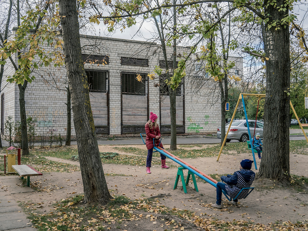 Children play on a playground outside a polling station on Sunday, October 11, 2015 in Babruysk, Belarus. The town has been proposed to house a new Russian air base, though whether that will happen is questionable. President Alexander Lukashenko, a longtime iron-fisted ruler of Belarus, was elected to a fifth term with a reported 83.5% of the vote, which international monitors said did not meet democratic standards.