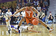 Guard Isaiah Taylor #1 of the Texas Longhorns scrambles for a loose ball against guard Justin Edwards #14 of the Kansas State Wildcats during the first half at Bramlage Coliseum in Manhattan, Kansas.