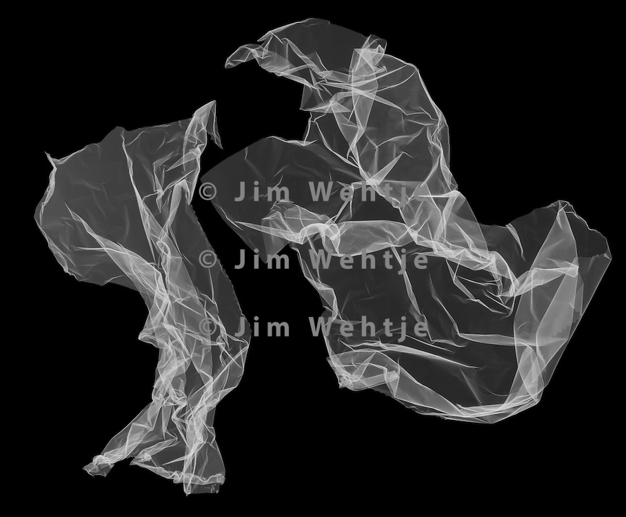 X-ray image of aluminum foil (white on black) by Jim Wehtje, specialist in x-ray art and design images.