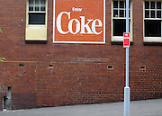 AUSTRALIA - SYDNEY  A 'Coke' sign painted on a wall on a street in Sydney  04/01/2010. STEPHEN SIMPSON...