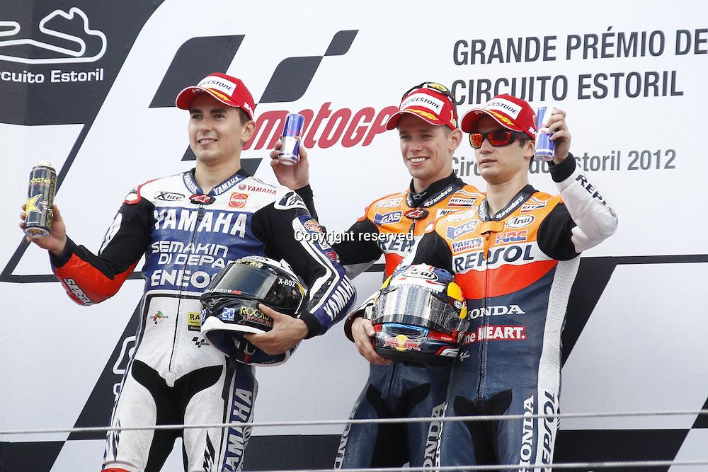 06.05.2012. Estoril, Portugal. Moto Grand Prix of Estoril. in The Picture C Stoner J Lorenzo and D Pedrosi  on the podium