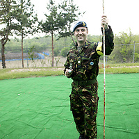 "PANMUNJOM, MAY-16: Flight lieutenant David Jobster from Scotland stands on the ""world's most dangerous"" golf course in the DMZ, Korea."