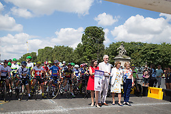 With local dignitaries, UCI President Brian Cookson opens the La Course, a 89 km road race in Paris on July 24, 2016 in France.