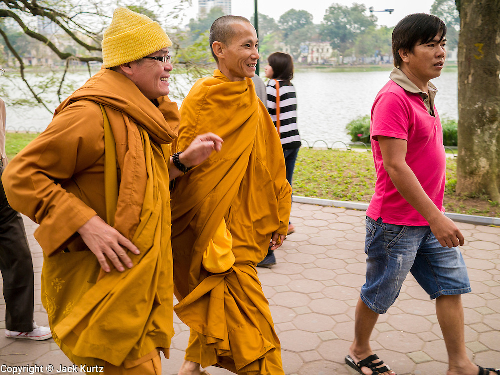 31 MARCH 2012 - HANOI, VIETNAM:  Buddhist monks walk around the shore of Lake Ho Hoan Kiem in the Old Quarter of Hanoi, Vietnam.  PHOTO BY JACK KURTZ