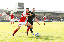 Gary Roberts of Wigan Athletic takes on Lewis Coyle of Fleetwood Town - Mandatory by-line: Robbie Stephenson/JMP - 21/04/2018 - FOOTBALL - Highbury Stadium - Fleetwood, England - Fleetwood Town v Wigan Athletic - Sky Bet League One