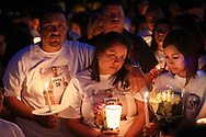 Family members, including Eric's mother, Alanis Rodriguez,  gather together for a candlelight vigil for Eric Medina at Pasadena High School on Sunday, May 3, 2015 in Pasadena, TX. Eric Rodriguez had a heart attack and died during a routine physical at school. Photo: Thomas B. Shea, For The Chronicle / © 2015