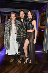 Left to right, CHARLOTTE CARROLL, DIEGO BIVERO-VOLPE and ELIZA CUMMINGS at the launch of MNKY HSE Restaurant, 10 Dover Street, London on 19th October 2016.