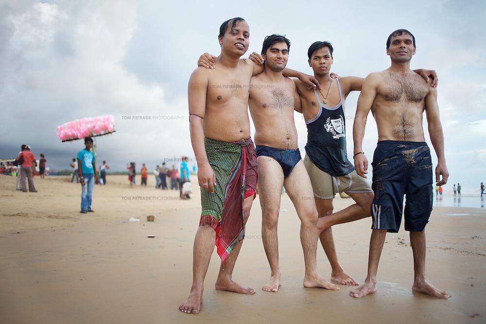 Bathers on the beach in Puri...Photo: Tom Pietrasik.Puri, Orissa. India.November 2009