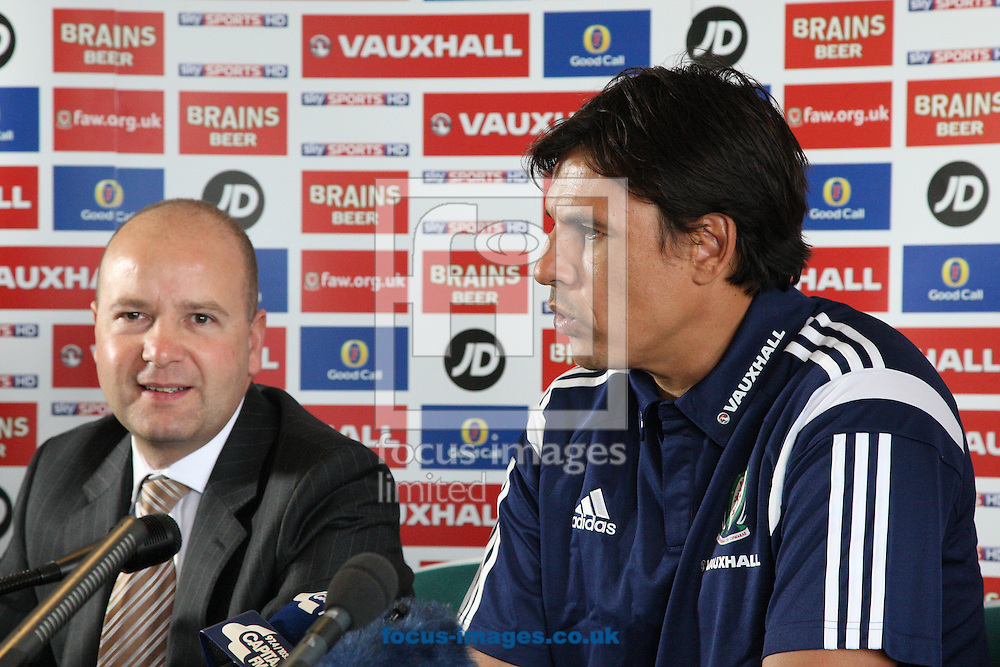 Picture by Mark Hawkins/Focus Images Ltd 07949 023795<br /> 15/11/2013<br /> FAW Chief Executive Jonathan Ford (left) and Chris Coleman (right) pictured during the FAW press conference at St David's Hotel, Cardiff.