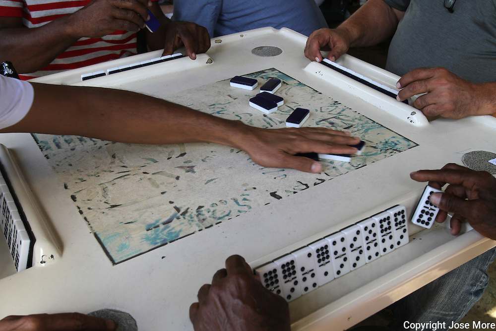 Maximo Gomez Domino Park is a landmark on Little Havana's Calle Ocho, and is always full of neighborhood domino players - usually older men who have mastered the game. Photography by Jose More