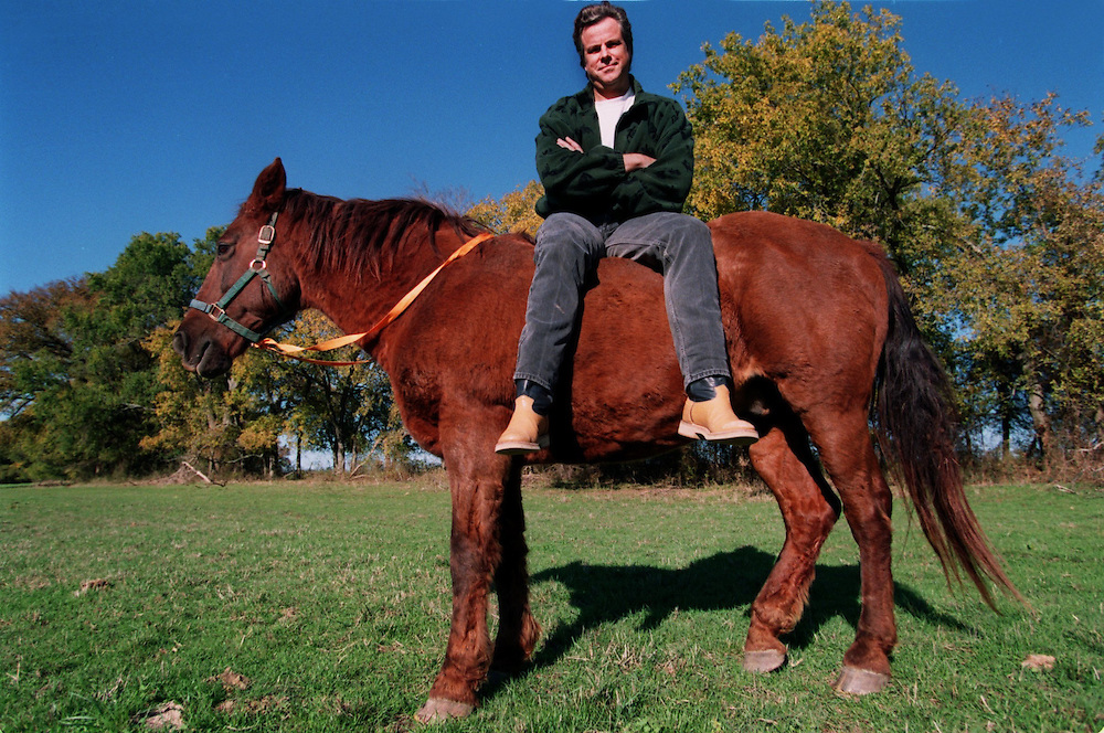Texas singer songwriter Robert Earl Keen,  who recently sold out 4 shows at the Gypsy Tea Room, sits on top  of a horse outside Dallas. Photographer: Allison V. Smith  Date: 19981127