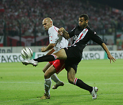 WARSAW, POLAND - WEDNESDAY, SEPTEMBER 7th, 2005: Wales' Craig Davies and Poland's Mariusz Jop during the World Cup Group Six Qualifying match at the Legia Stadium. (Pic by David Rawcliffe/Propaganda)