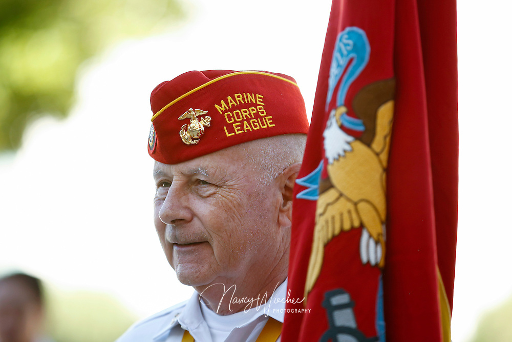 Veteran Gerry Schaller holds the Marine Corps flag following the sixth annual Red, White and Blue Mass at St. Thomas Aquinas Church in Avondale, Ariz., Nov. 6. The Diocese of Phoenix marked the occasion to honor active and retired service men and women and to recall those who died in service to the country. (CNS photo/Nancy Wiechec)