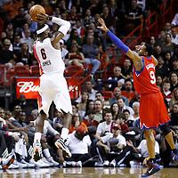 21 January 2012: Miami Heat small forward LeBron James (6) takes a jumpshot over Philadelphia Sixers small forward Andre Iguodala (9) during the Miami Heat 113-92 victory over the Philadelphia Sixers at the AmericanAirlines Arena, Miami, Florida, USA.