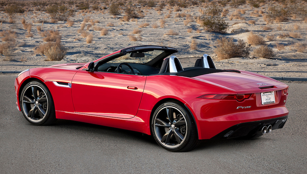 rear view of a red 2014 Jaguar F-Type photographed in the Desert of Palm Springs, CA