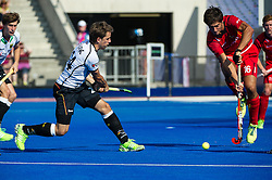 Belgium's Alexander Hendrickx blocks the shot of  of Germany. Belgium v Germany - Unibet EuroHockey Championships, Lee Valley Hockey & Tennis Centre, London, UK on 22 August 2015. Photo: Simon Parker