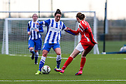 Brighton's Sophie Perry takes on Kayleigh Green during the FA Women's Premier League match between Brighton Ladies and Cardiff City Ladies at Brighton's Training Ground, Lancing, United Kingdom on 22 March 2015. Photo by Geoff Penn.