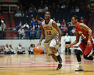 """Ole Miss' Jarvis Summers(32) vs. Louisiana-Lafayette's Raymone Andrews (22) at C.M. """"Tad"""" Smith Coliseum in Oxford, Miss. on Wednesday, December 14, 2011. (AP Photo/Oxford Eagle, Bruce Newman)"""