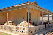 House with strings of garlic in Velasco, Holguin, Cuba.