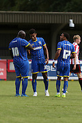 Lyle Taylor celebrates during the Pre-Season Friendly match between AFC Wimbledon and Cheltenham Town at the Cherry Red Records Stadium, Kingston, England on 1 August 2015. Photo by Stuart Butcher.