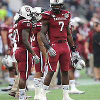 South Carolina Gamecocks defensive end Jadeveon Clowney (7) is seen prior to the NCAA Capital One Bowl football game between the South Carolina Gamecocks who represent the SEC and the Wisconsin Badgers who represent the Big 10 Conference, at the Florida Citrus Bowl on Wednesday, January 1, 2014 in Orlando, Florida. (AP Photo/Alex Menendez)