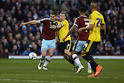 Sam Vokes of Burnley tries to hold off Grant Leadbitter of Middlesbrough on the edge of the box during the Sky Bet Championship match between Burnley and Middlesbrough at Turf Moor, Burnley, England on 19 April 2016. Photo by Simon Brady.
