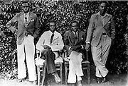 Leaders of the Sudanese Association and a renowned religious leader have their photo taken at the Kibra-Makongeni (or Whitehouse) after a meeting. (circa 1940s)