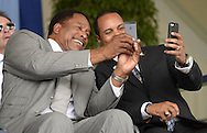 "COOPERSTOWN, NY - JULY 27:  Baseball Hall of Famers Dave Winfield (L) and Barry Larkin take ""selfless"" prior to the 2014 induction ceremonies held at the Clark Sports Center in Cooperstown, New York on July 27 2014."