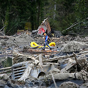 A rescue worker negotiates the debris field near Oso, Wash. Photographed on Tuesday, March 25, 2014 near Oso, Wash. (Joshua Trujillo, seattlepi.com)