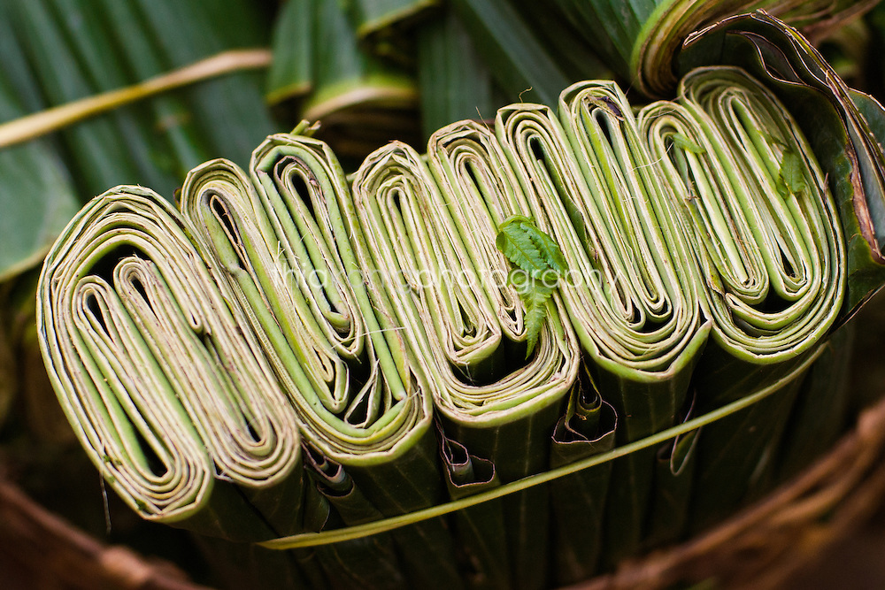 Detail of folded palm leaves in pattern at market, Ubud, Bali