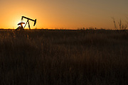 A pump jack and a west Texas sunset in Big Spring, Texas.