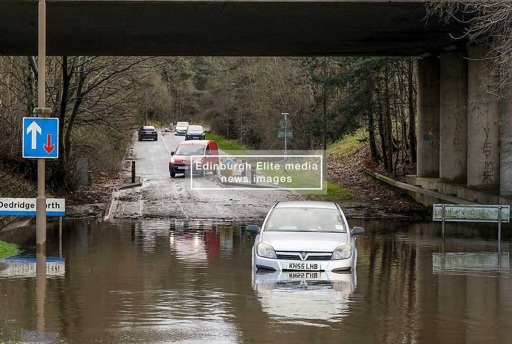 Storm Ciara, 9 February 2020<br /> <br /> Pictured: A car is abandoned after becoming stuck in flood waters in Livingston, West Lothian<br /> <br /> Alex Todd   Edinburgh Elite media