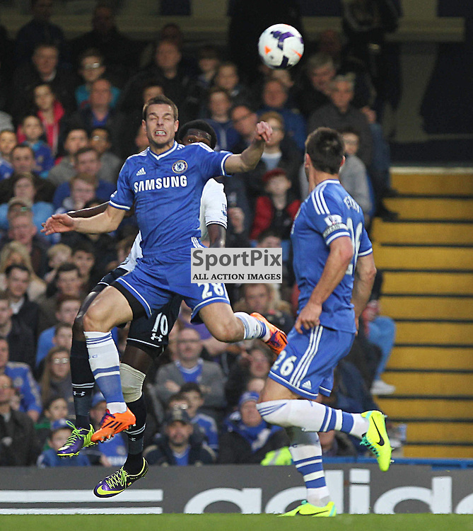 Chelsea's Cesar Azpilcueta jumps for the ball during the English Barclays Premiership match between Chelsea FC and Tottenham Hotspur FC at Stamford Bridge, London, 8th March 2014 © Phil Duncan | SportPix.org.uk