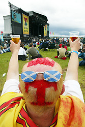 A fan with coloured T in his hair near the main stage area at T in the Park Saturday 8 July 2006, at Balado, Fife...
