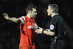 Leyton Orient's Andrea Dossena  protests with the referee - Photo mandatory by-line: Dougie Allward/JMP - Mobile: 07966 386802 - 03/03/2015 - SPORT - football - Leyton - Brisbane Road - Leyton Orient v Bristol City - Sky Bet League One