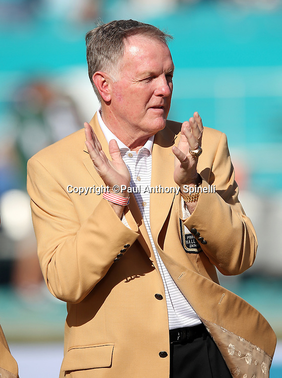Former Miami Dolphins quarterback Bob Griese claps during a halftime event awarding former Miami Dolphins head coach Don Shula his Pro Football Hall of Fame ring during the Miami Dolphins 2015 week 11 regular season NFL football game against the Dallas Cowboys on Sunday, Nov. 22, 2015 in Miami Gardens, Fla. The Cowboys won the game 24-14. (©Paul Anthony Spinelli)
