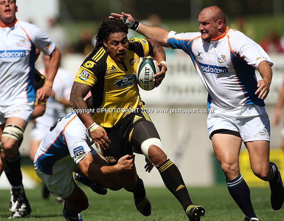 Hurricanes second five Ma'a Nonu tries to get through the tackles of Hennie Daniller and Bees Roux (right).<br /> Super 14 rugby union match, Hurricanes v Cheetahs at Yarrows Stadium, New Plymouth, New Zealand. Saturday 7 March 2009. Photo: Dave Lintott/PHOTOSPORT