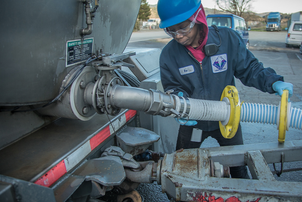 Crystal Geyser Quality Control employee Raen Nelson unloads a tanker truck at the company's facility in Calistoga.