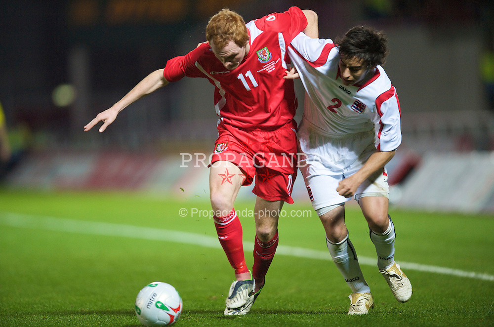 LLANELLI, WALES - Tuesday, March 31, 2009: Wales' Shaun MacDonald and Luxembourg's Massio Martino during the UEFA Under-21 Championship Group 3 match at Parc-Y-Scarlets. (Pic by David Rawcliffe/Propaganda)