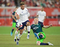 NEW YORK, NEW YORK, USA - Wednesday, July 24, 2019: Liverpool's Alex Oxlade-Chamberlain (L) and Jérémy Mathieu during a friendly match between Liverpool FC and Sporting Clube de Portugal at the Yankee Stadium on day nine of the club's pre-season tour of America. (Pic by David Rawcliffe/Propaganda)