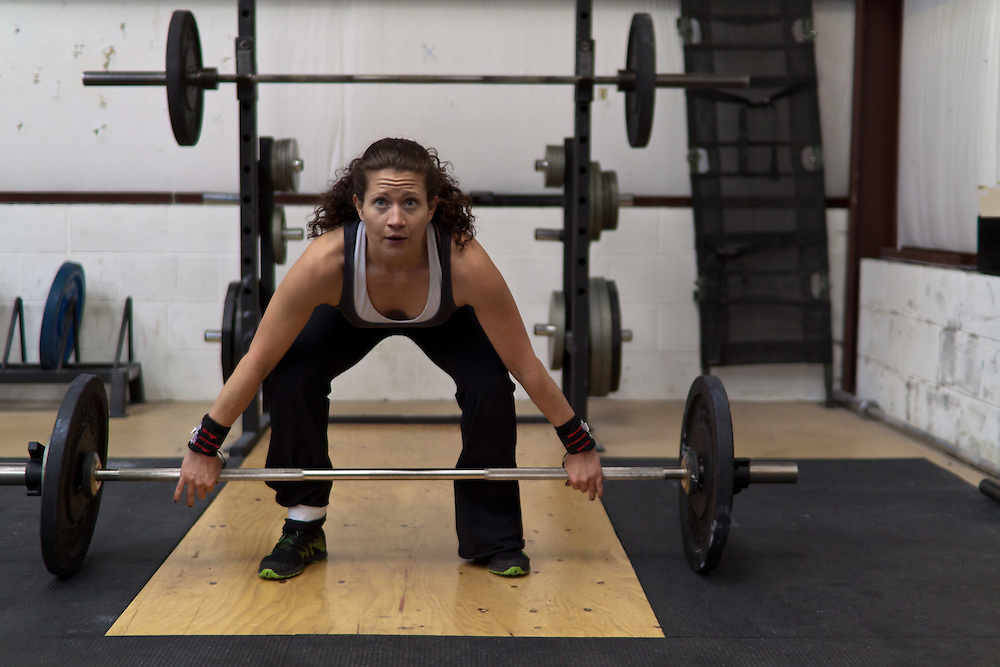 Venassa Sandoval does a snatch during a WOD, Crossfit image, picture, photo, photography of health, elite, exercise, training, workouts, WODs, taken at Progressive Fitness CrossFit,Colorado Springs, Colorado, USA.