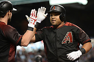 Apr 22, 2017; Phoenix, AZ, USA; Arizona Diamondbacks left fielder Yasmany Tomas (24) is congratulated by shortstop Chris Owings (16) after hitting a solo homer in the first inning against the Los Angeles Dodgers at Chase Field. Mandatory Credit: Jennifer Stewart-USA TODAY Sports