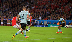 LILLE, FRANCE - Friday, July 1, 2016: Wales' Hal Robson-Kanu turns two Belgium defenders before scoring the second goal during the UEFA Euro 2016 Championship Quarter-Final match at the Stade Pierre Mauroy. (Pic by David Rawcliffe/Propaganda)