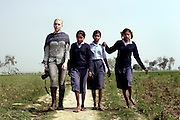 Having left the purvaiachal dalit Balika school Scarlett makes her way with school girls (L to R) Gudiya, Rinki and Gudiya to their homes.